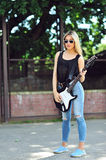 An image of a young woman with guitar Royalty Free Stock Image