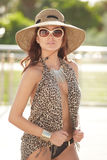 Image of a young woman posing in animal print. Image of a fashionable young woman in animal print clothing stock photo