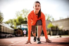 Image of young woman prepare for run. Outside. Young sport woman. On the move Stock Image