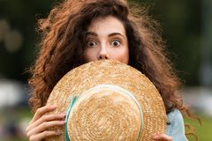 Image of young woman holding straw hat royalty free stock images