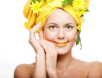 Image of a young woman with yellow chrysanthemums Stock Photo