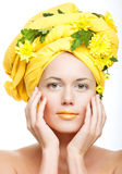 Image of a young woman with yellow chrysanthemums Royalty Free Stock Image