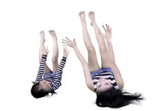 Young woman and her daughter lying down together Stock Image