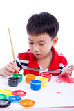 Imagem asiática da tração do menino usando instrumentos de desenho, conce da faculdade criadora Fotos de Stock
