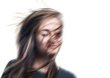Imagem borrada de uma jovem mulher com os olhos fechados Fotografia de Stock