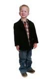 Imagem cheia do comprimento de um rapaz pequeno no branco Fotografia de Stock