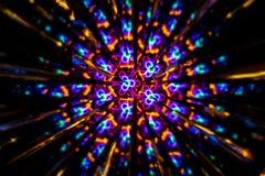 Imagem circular feita com um caleidoscópio Reflexão de luzes que gera imagens do tipo do fractal imagem de stock royalty free