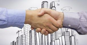 Imagem colhida dos homens de negócios que fazem o aperto de mão com as construções tiradas no fundo Fotografia de Stock Royalty Free