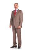 Imagem completa do corpo de uma posição superior madura do homem de negócios Foto de Stock