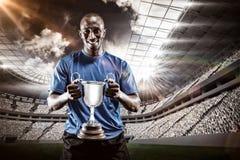 Imagem composta 3D do retrato do atleta feliz que guarda o troféu Fotografia de Stock Royalty Free