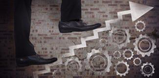Imagem composta da baixa seção de etapas de escalada do homem de negócios Imagem de Stock