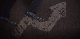 Imagem composta da baixa seção de etapas de escalada do homem de negócios Foto de Stock Royalty Free