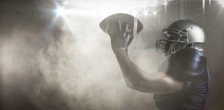 Imagem composta da bola de travamento do jogador de futebol americano Foto de Stock Royalty Free