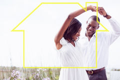 Imagem composta da dança e do sorriso românticos dos pares Imagem de Stock Royalty Free