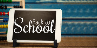 Imagem composta da imagem digital de volta ao texto de escola Fotos de Stock