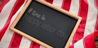 Imagem composta da imagem composta digital do tempo ao texto feliz do Dia do Trabalhador Fotos de Stock Royalty Free