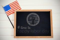 Imagem composta da imagem composta digital do tempo ao texto feliz do Dia do Trabalhador Foto de Stock Royalty Free