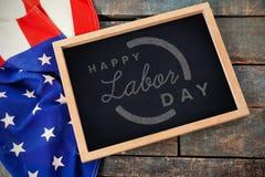 Imagem composta da imagem composta digital do texto feliz do Dia do Trabalhador com esboço azul Fotos de Stock