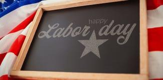 Imagem composta da imagem composta digital do texto feliz do Dia do Trabalhador com forma da estrela Fotografia de Stock Royalty Free
