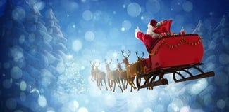 Imagem composta da equitação de Papai Noel no trenó com caixa de presente imagem de stock royalty free