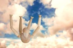 Imagem composta da estatueta 3d marrom que exercita no assoalho Fotografia de Stock Royalty Free