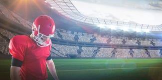 Imagem composta da focalização do jogador de futebol americano fotos de stock