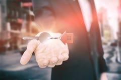 Imagem composta da ideia de ângulo alto do keychain home vermelho com chave de prata Imagens de Stock