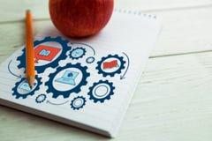 Imagem composta da imagem composta de ícones da educação nas engrenagens Imagens de Stock Royalty Free