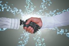 Imagem composta da imagem composta do homem de negócios e do robô que agitam as mãos Fotografia de Stock