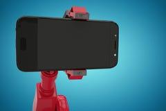 Imagem composta da imagem composta do robô vermelho que mostra o telefone esperto 3d imagens de stock royalty free