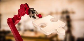 Imagem composta da imagem digital da mão robótico vermelha que guarda a parte 3d do enigma Imagens de Stock Royalty Free