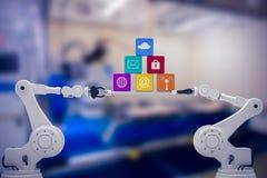 Imagem composta da imagem digitalmente composta das mãos robóticos que guardam ícones do computador Fotografia de Stock
