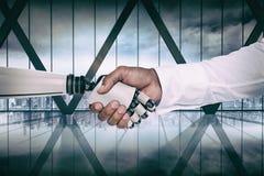 Imagem composta da imagem do gráfico de computador do homem de negócios e do robô que agitam as mãos Fotos de Stock