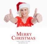 Imagem composta da jovem mulher de sorriso que põe seus polegares acima na satisfação Fotos de Stock Royalty Free