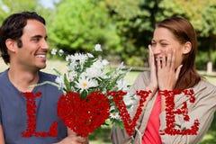 Imagem composta da jovem mulher que mantém suas mãos contra sua cara quando apresentado com flores Foto de Stock
