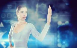 Imagem composta da jovem mulher que olha sua palma Foto de Stock