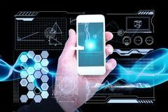 Imagem composta da mão do homem de negócios que guarda os telefones espertos 3d Foto de Stock Royalty Free