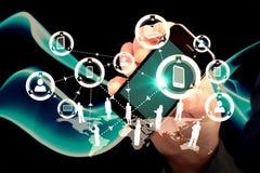 Imagem composta da mão do homem de negócios que mostra o smartphone 3d Imagens de Stock Royalty Free