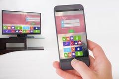 Imagem composta da mão fêmea que guarda um smartphone Fotos de Stock