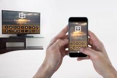 Imagem composta da mão fêmea que guarda um smartphone Imagem de Stock