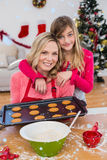 Imagem composta da menina festiva que faz cookies do Natal Foto de Stock Royalty Free