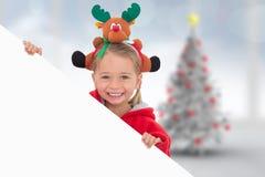 Imagem composta da menina festiva que mostra o cartaz Fotos de Stock Royalty Free