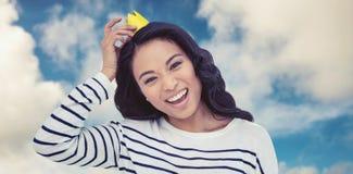 Imagem composta da mulher asiática de sorriso com coroa de papel Imagem de Stock Royalty Free