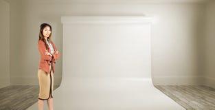 Imagem composta da mulher de negócios de sorriso com braços cruzados Imagem de Stock Royalty Free