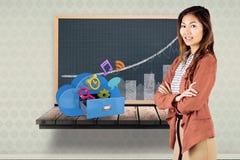 Imagem composta da mulher de negócios de sorriso com braços cruzados Imagens de Stock Royalty Free
