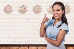 Imagem composta da mulher de negócios de sorriso com polegares acima Imagens de Stock Royalty Free