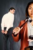 Imagem composta da mulher de negócios que golpeia um martelo da lei no martelo fotos de stock royalty free