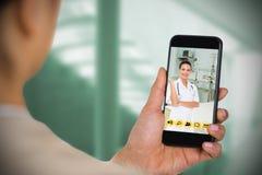 Imagem composta da mulher de negócios que usa o telefone celular Foto de Stock