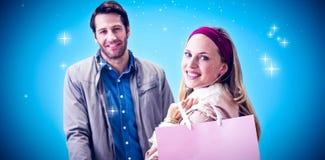 Imagem composta da mulher de sorriso com o saco de compras na frente do caixa fotografia de stock