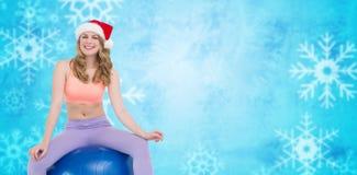 Imagem composta da mulher loura de sorriso que senta-se na bola do exercício Fotos de Stock Royalty Free